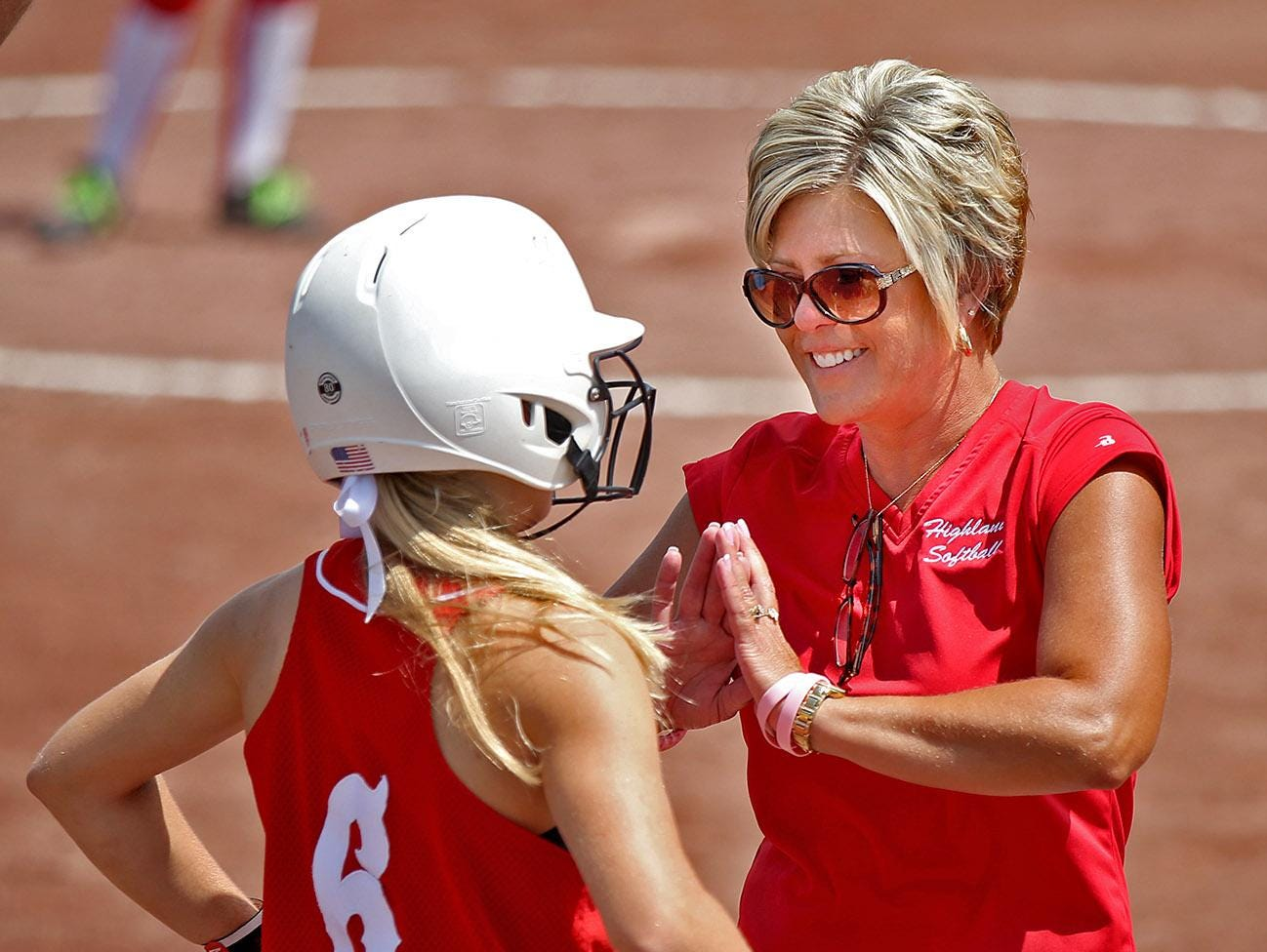 Highland ( Riverside ) head coach Carrie Wieland talked with Kelsey Hora after Hora was safe in a rundown between third and home against St. Ansgar in Class 2-A quarterfinal game at the 2014 Girls State Softball Tournament in Ft. Dodge on Tuesday July 22, 2014