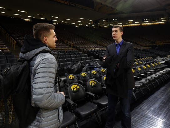 Iowa's Jordan Bohannon, left, chats with his older