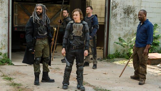 King Ezekiel (Khary Payton), front left, Benjamin (Logan Miller) and Morgan (Lennie James)  on the set of AMC's 'The Walking Dead.'