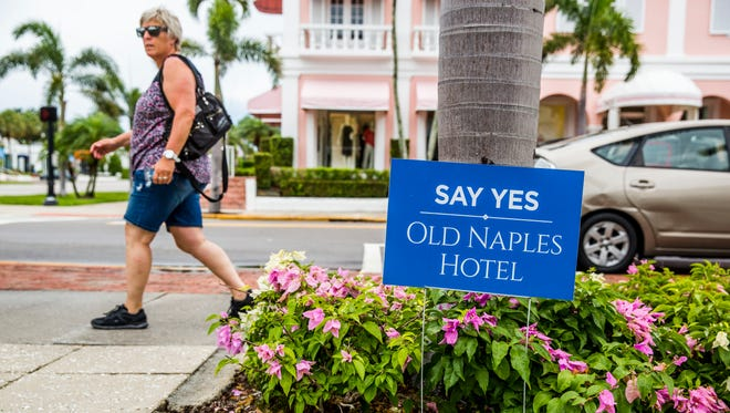 Signs are set out along Third Street South and the surrounding neighborhood regarding the new Old Naples Hotel plans on Monday, May 14, 2018. The Naples City Council takes a final vote on the hotel plans Wednesday.