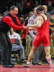 Rutgers coach Scott Goodale congratulates Richie Lewis