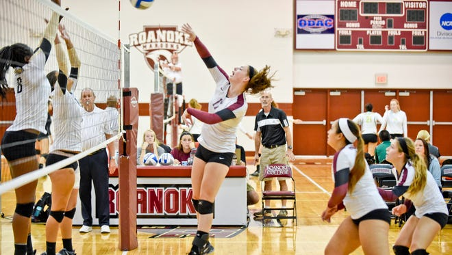 Logan Graves knocks the ball over the net during a match. Graves is a former Waynesboro standout that now plays at Roanoke College.