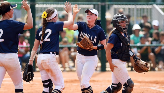 Aucilla Christian's Abigail Morgan (from left), Elizabeth Hightower, Ramsey Sullivan and Kelly Horne celebrate the end of the fourth inning on Wednesday, May 17, 2017 during the FHSAA Softball Championships at Historic Dodgertown in Vero Beach. The Warriors won the game 5-0.