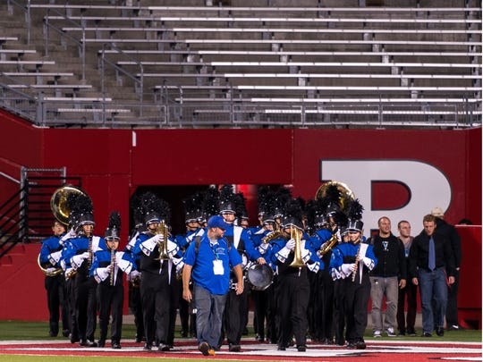 Metuchen High School Marching Band director John Messenger leads the band into High Point Solutions Stadium for the 2014 U.S.Bands 4 Open State Championships