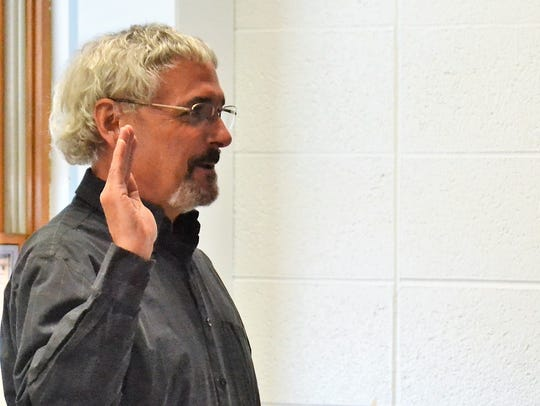 John Pinkart takes the oath of office for the Oconto