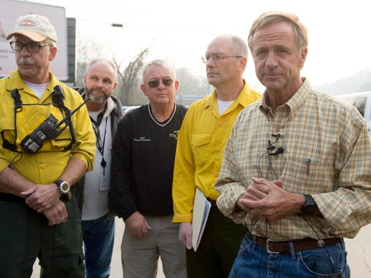 Tennessee Gov. Bill Haslam, right, holds a news conference while visiting with volunteers and firefighters at Blount County Fire Station 5 on Wednesday, Nov. 23, 2016 in Walland. With him are, from left, Bruce Miller of the Tennessee Division of Forestry, Blount County Emergency Management Agency Director Lance Coleman,  Blount County Fire Chief Doug McClanahan, and Darren Bailey, of the the Tennessee Division of Forestry.