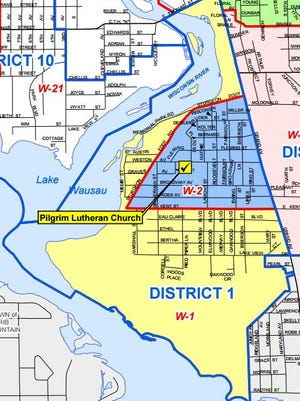A map of Wausau's 1st City Council District includes the municipal airport. The blue lines delineate the district and the red lines show separate wards.