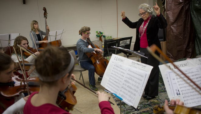 School for Strings director Rebekah Brown leads a group of students during a rehearsal.