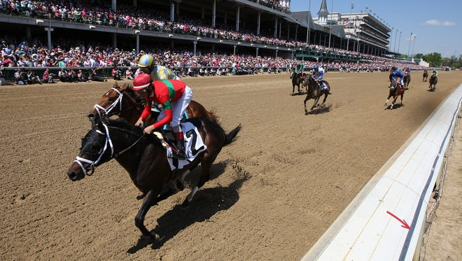 Noble Bird, left, with Shawn Bridgmohan up, battles with Protonico, right, with John Velazquez up, in the stretch.  Protonico held on to win the Alysheba.May 1, 2015