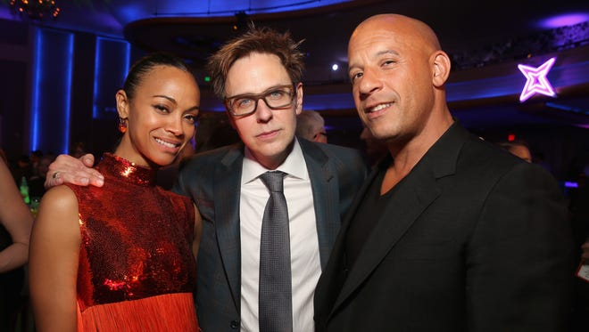 Zoe Saldana, writer/director James Gunn and Vin Diesel at the world premiere of 'Guardians of the Galaxy Vol. 2.'