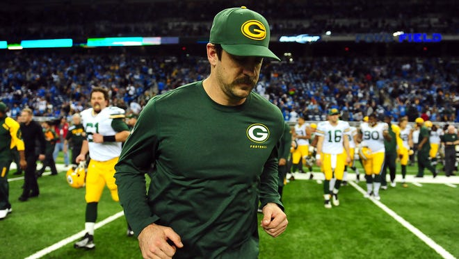 Green Bay Packers quarterback Aaron Rodgers (12) runs off the field after losing to the Detroit Lions 40-10 during a NFL football game on Thanksgiving at Ford Field.