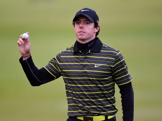 Northern Ireland's Rory McIlroy completes his round during day three of the BMW PGA Championships at the Wentworth Club, Virginia Water England Saturday May 24, 2014.(AP Photo/PA, Adam Davy) UNITED KINGDOM OUT