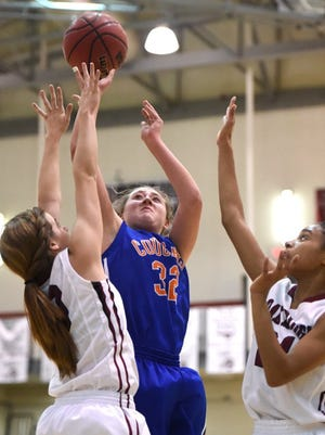 Campbell County's Skylar Boshears (32) attempts a host against Oak Ridge defenders during a high school basketball game at Oak Ridge High School on Tuesday, Jan. 12, 2016.