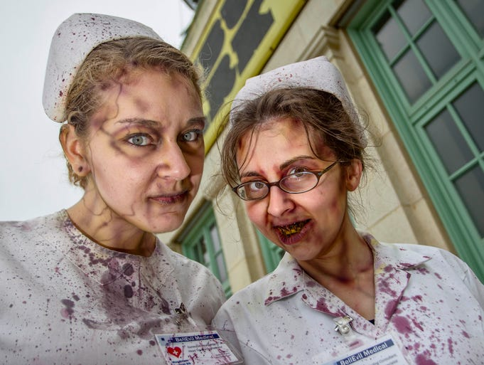 """Nearly 10,000 """"zombies"""" -- 9.592 to be exact -- made their way to Asbury Park, N.J., on Oct. 5, 2013,  to successfully break the Guinness World Records' """"Largest Gathering of Zombies."""" The New Jersey Zombie Walk partnered with Stronger Than the Storm to honor the Jersey Shore's rebuilding after Hurricane Sandy.  Zombie nurses Melissa Johnson, left, and Diane Lyons exited the operating room a bit early to take part."""