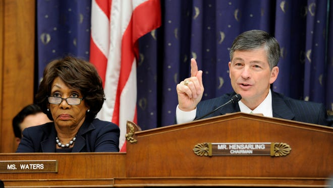 House Financial Services Committee Chairman Rep. Jeb Hensarling, R-Texas, questions Treasury Secretary Jacob Lew on Capitol Hill in Washington, Tuesday, June 24, 2014, during the committee's hearing. At left is the committee's ranking member Rep. Maxine Waters, D-Calif.