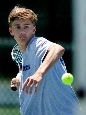 Montgomery Academy's Clayton Muller competes in the Class 1A-3A Boys Sectional Tennis Tournament at O'Connor Tennis Center in Montgomery, Ala. on Monday April 16, 2014.