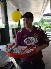 Jake McFarlen, hands out condiments to guests at the Sonic Drive-In the Monroe Highway in Pineville. McFarlen is one of the crew members set to compete at the Sonic Games in Nashville.
