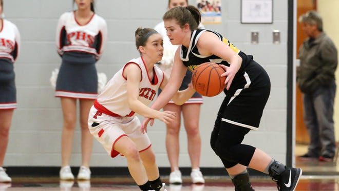 Paint Valley's Lexi Woods is guarded by Piketon's Avery Reuter Thursday at Piketon High School. The two juniors have become great friends through the game of basketball.