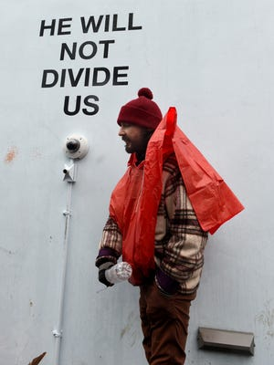 Shia LaBeouf, seen here at the original site of his 'He Will Not Divide Us,' says there were reports of gunshots at its new home in Albuquerque, prompting a shutdown.