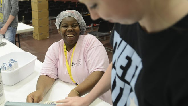 Jelly Winfrey, 19, helps seal food bags at Freed-Hardeman University's Go! Camp on Tuesday.