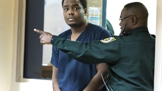 Dametri Dale enters court Wednesday, March 18, 2020. Dale, who is charged with first-degree murder in the contract killing of Lantana mother of three Makeva Jenkins in 2017, this week was confronted with new evidence against him.