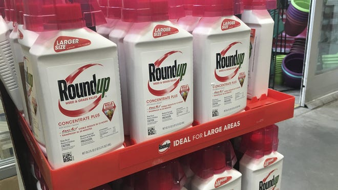FILE - In this, Feb. 24, 2019, file photo, containers of Roundup are displayed at a store in San Francisco. German pharmaceutical company Bayer announced Wednesday, June 24, 2020, it's paying up to $10.9 billion to settle a lawsuit over subsidiary Monsanto's weedkiller Roundup, which has faced numerous lawsuits over claims it causes cancer.