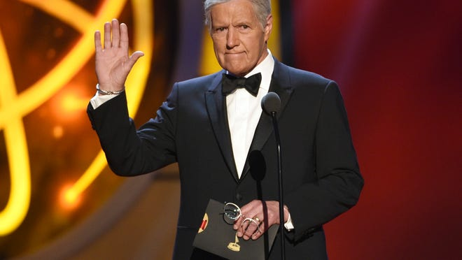 "FILE - This May 5, 2019, file photo shows Alex Trebek gestures while presenting an award at the 46th annual Daytime Emmy Awards in Pasadena, Calif. Jeopardy!"" host Alex Trebek died Sunday, Nov. 8, 2020, after battling pancreatic cancer for nearly two years. Trebek died at home with family and friends surrounding him, ""Jeopardy!"" studio Sony said in a statement. Trebek presided over the beloved quiz show for more than 30 years."