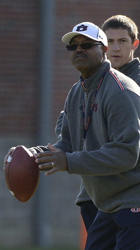 Safeties coach Charlie Harbison will serve as Auburn's defensive coordinator for the Outback Bowl.