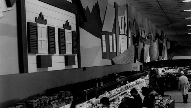 An Erie Canal theme decorated the walls above the meat department inside the Spencerport Bells store.