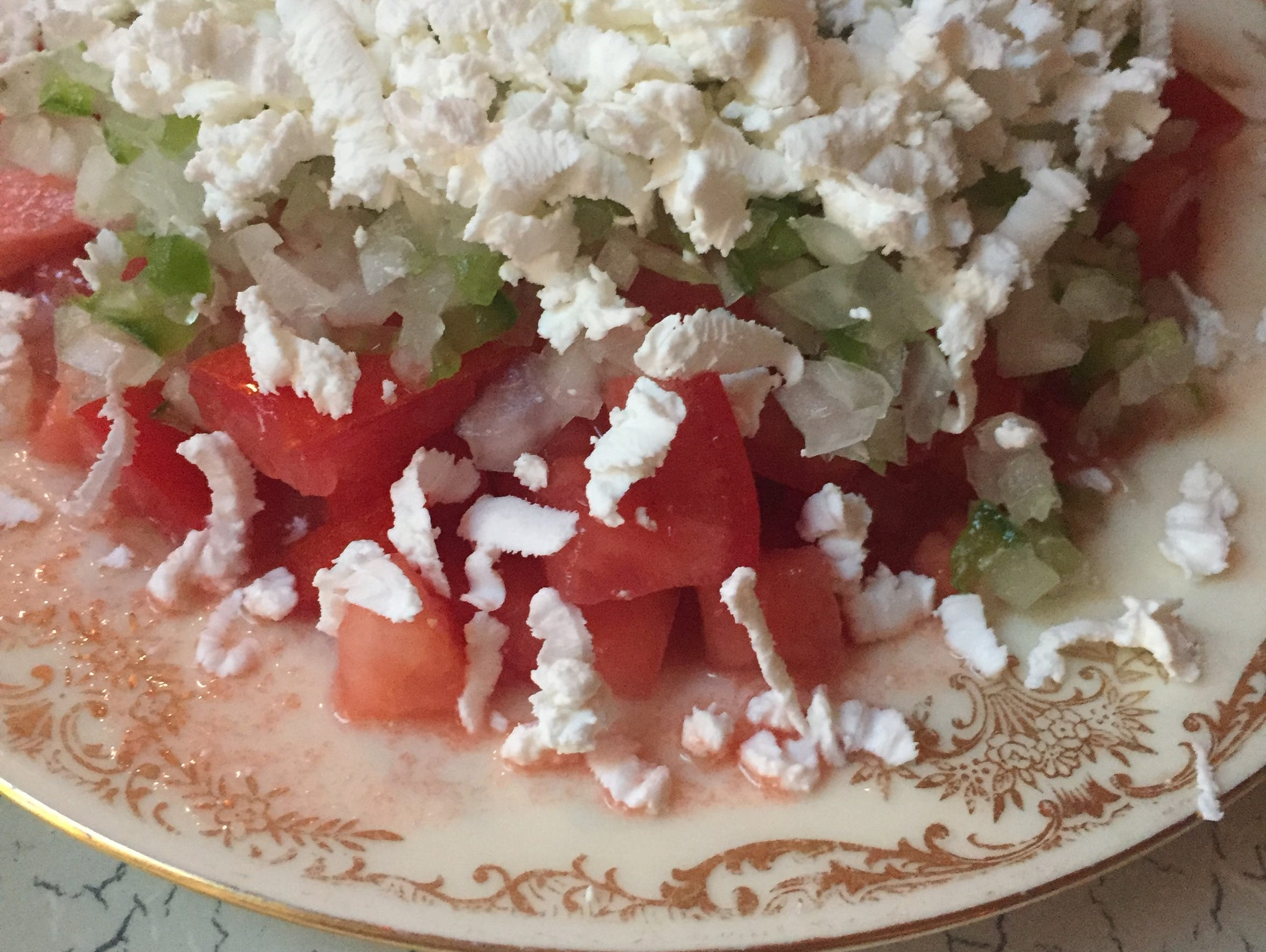 The Serbian tomato salad with onion and green pepper