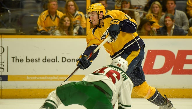 Nashville's Colton Sissions gets past Minnesota's Jared Spurgeon for a shot in the third period at the Bridgestone Arena in Nashville, Tenn., Saturday, April 1, 2017.