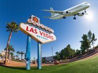 Welcome sign to Las Vegas with airplane in the sky