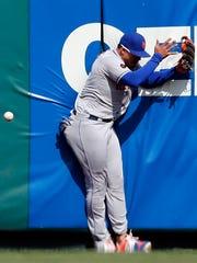 New York Mets center fielder Juan Lagares is unable