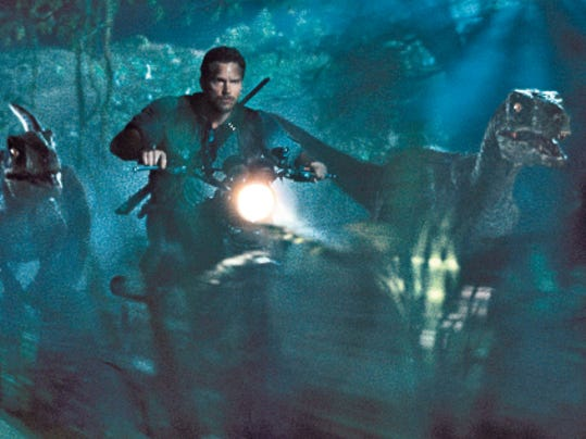 "Chris Pratt as Owen leading the raptors on a mission in a scene from the film, ""Jurassic World,"" directed by Colin Trevorrow, in the next installment of Steven Spielberg's groundbreaking ""Jurassic Park"" series. The Universal Pictures 3D movie releases in theaters on Friday."