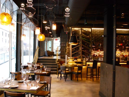 636518170346637658-Deacon-s-Interiors-entering-the-main-level-dining-room-and-bar.jpg