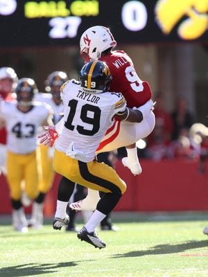 Nebraska Cornhuskers wide receiver Keyan Williams makes a catch against Iowa Hawkeyes defensive back Miles Taylor in the first quarter at Memorial Stadium on Nov. 24, 2017.