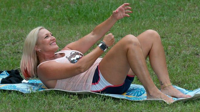 Marlo Alleva demonstrates rope climbing crunches.