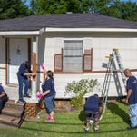Capital One Bank associates, family members and friends paint a home in Shreveport's Martin Luther King neighborhood as part of Paint Your Heart Out Shreveport 2015.