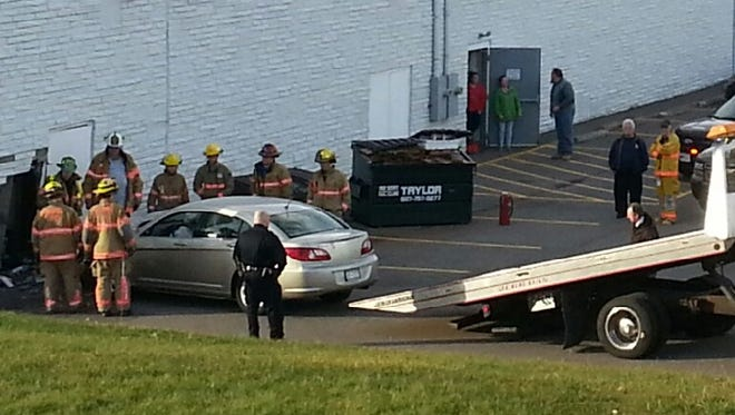 Emergency responders at the scene of a car into a building in Vestal on Monday afternoon. Minor injuries were reported.