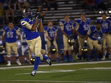 Reed's Michael Spivack hauls in a touchdown catch while taking on Carson during their game at Mackay Stadium in Reno on Aug. 29, 2015.