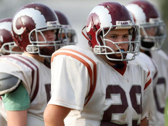 Meghan Moore (No. 29) was a two-way tackle for the South River High School football team in 2012.