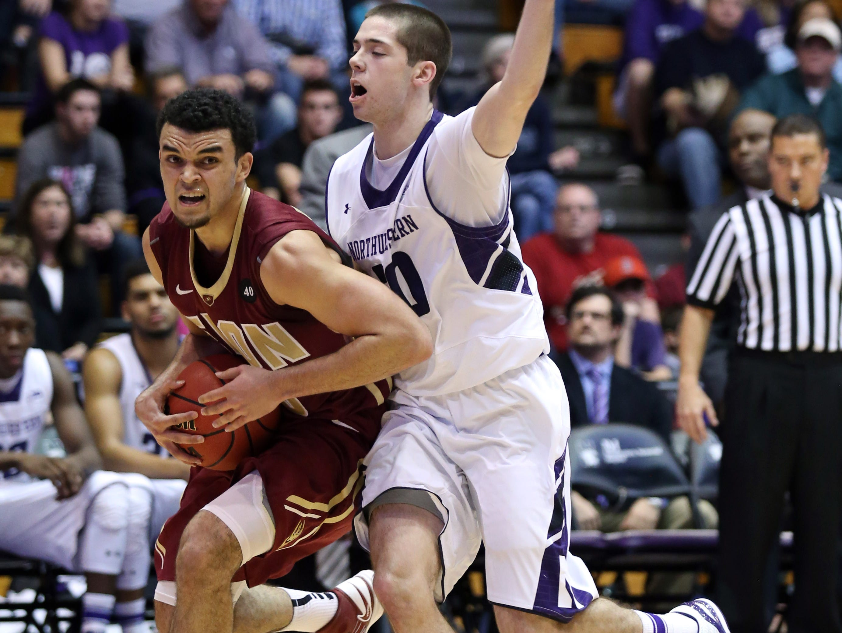Elon guard Elijah Bryant (left) is considering a transfer to Butler.