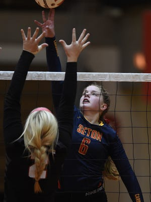 Seton Catholic's Sarah Dickman hits against Richmond's Brooklyn Vickers during a volleyball match Tuesday, Oct. 4, 2016 at Richmond High School.