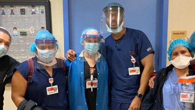Medical healthcare workers from New York Presbyterian Hospital wear face shields produced by Delaware Valley High School teachers Tom Moran and Bob Curtis.