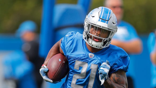 Lions running back Ameer Abdullah carries the football at training camp in Allen Park, July 30, 2017.