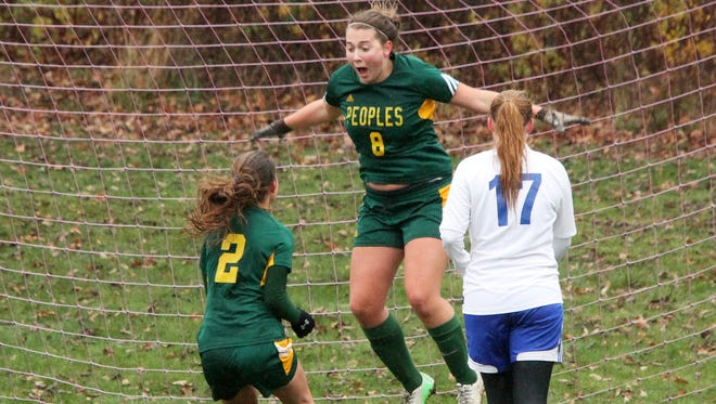 Peoples Academy senior Izzy Weiss leaps into the air after scoring the first goal of her career, which turned out to be the game-winner, in the Wolves' 1-0 win over the Blue Devils in the Division III high school girls state championship game on Saturday, Nov. 1, 2014 at Williamstown High School.