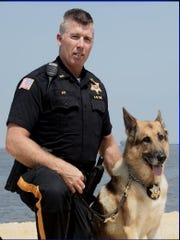 Officer James Fay and Sheriff's K-9 Officer Falko