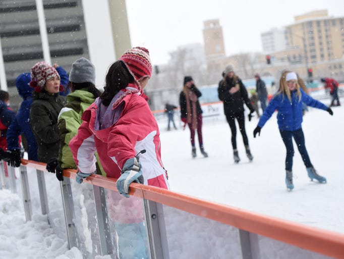 People brave the snowstorm to skate at the Reno Ice