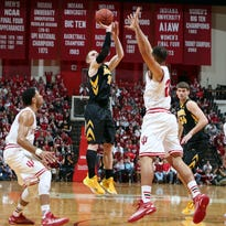 Iowa guard Mike Gesell rises and fires against Indiana. Iowa won the game, 77-63, and now has a chance at a double bye at the Big Ten Tournament next week.