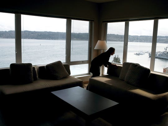 Spyglass Hill property manager Victoria Luke in a corner apartment with views of the Turner Joy and the Bremerton waterfront.